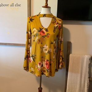 Floral top with cut out and bell sleeves